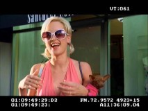 Paris Hilton Look-Alike (Alla Petrou) laughs in the Outtakes reel.