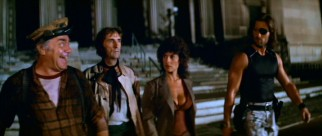 The eccentric Cabby (Academy Award winner Ernest Borgnine), Brain (Harry Dean Stanton), Maggie (Adrienne Barbeau) and Snake (Kurt Russell) leave the New York Public Library that is now The Duke's domain.