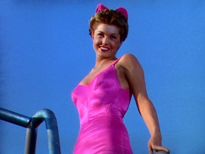 "Clad in a bright pink swimsuit, Esther Williams makes her first appearance in her first leading role, in ""Bathing Beauty."""