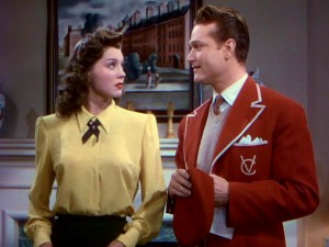 "Steve Elliott (Red Skelton) dons the scarlet blazer and beret of Victoria College (for Girls) just to be close to Caroline (Esther Williams) in ""Bathing Beauty."""