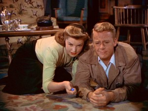 "Heiress Connie Allenbury (Esther Williams) and undercover reporter Bill Chandler (Van Johnson) bond over marbles in ""Easy to Wed."""