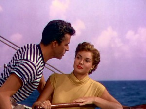 "Katy (Esther Williams) looks unfazed as Andre (Fernando Lamas) pours his heart into the song ""In My Wildest Dreams."" Maybe she's just not that into you, man."