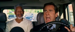 Evan Baxter (Steve Carell) is surprised to find a man claiming to be God (Morgan Freeman) instantly appearing in the backseat of his Hummer.