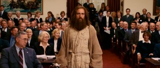 All eyes in Congress turn towards Evan as he makes a bold fashion statement with his robe, cloak, and crazy hair.