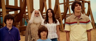 Evan's photogenic wife (Lauren Graham) and three kids (Graham Phillips, Jimmy Bennett, Johnny Simmons) stay by his side as others cast doubt on his transformation.