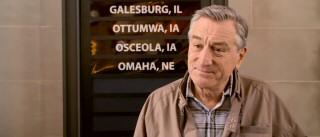 An Illinois train station board displays some of the stops Frank Goode (Robert De Niro) won't be taking as part of his cross-country journeys to visit his kids.