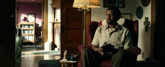 Taking refuge in his religiously-decorated living room, Barris (Forest Whitaker) still can't escape the incessant rants from his mother in the next room.
