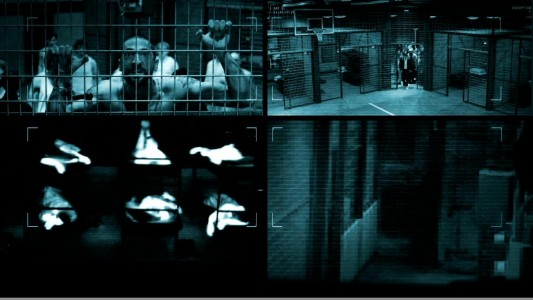 The Blu-ray Disc's main menu presents four security camera windows that each display their own footage of the prison and its inhabitants.