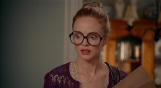 At the film's start, Texas accountant Alexandra Case (Heather Graham) is kind of a nerd, as her large glasses indicate.