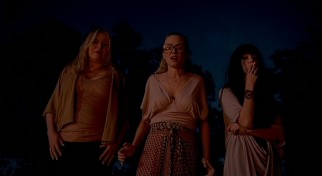 Stella (Jennifer Coolidge), Alex (Heather Graham), and Nikki (Amber Heard) process the fiery consequences of their spiteful driving.
