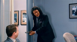 Ambulance-chasing lawyer Joe Adler (KISS rocker Gene Simmons) offers to revise his client's proposed settlement figure, with one unusual term involving this door.