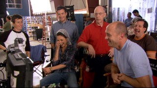"Writer/director Mike Judge (second from right), producer John Altschuler, and two of three cast members appear to enjoy playback of a just-filmed scene in the featurette ""Mike Judge's Secret Recipe."""
