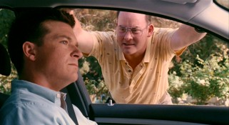 David Koechner amuses as persistent neighbor Nathan, who's always around to extend Joel's ride home.