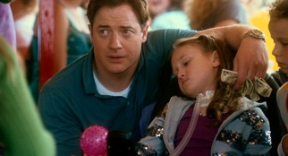 Concerned by Megan's (Meredith Droeger) new inability to throw a ball at a carnival attraction, Dad (Brendan Fraser) lends a helping hand.