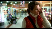 Aileen (Keri Russell) telephonically questions her husband's actions, while Megan acts out in the background of this deleted shopping scene.