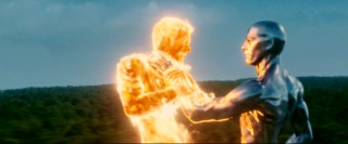 Fire meets metal as the Silver Surfer puts the Human Torch in a chokehold.