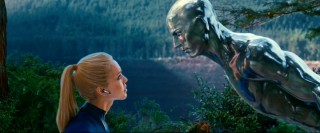 The Silver Surfer leans in for a closer look at Jessica Alba's blonde wig.