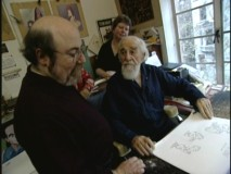 "Director Eric Goldberg looks over some of renowned artist Al Hirschfeld's sketches in ""Creating Rhapsody in Blue."""
