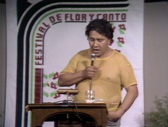 "Oscar Zeta Acosta reads from his book ""The Revolt of the Cockroach People"" at the Festival de Flor y Canto (Festival of Flower and Song)."