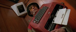 Hunter S. Thompson's alter ego Raoul Duke (Johnny Depp) lugs his trusty red typewriter around a Las Vegas hotel.