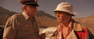 In violation of numerous laws, Raoul Duke gets pulled over by California highway patrolman H. Sulliven (Gary Busey).