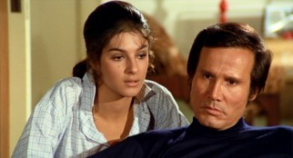 "Stone-faced killer Nick Lanzetta (Henry Silva) and his unlikely love interest, don's nephew Rina (Antonia Santilli), anticipate trouble in ""Il Boss"" (""The Boss"")."