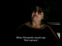 "Late Italian actress Francesca Romana Coluzzi is interviewed in low light in the featurette ""Roots of the Mafia."""