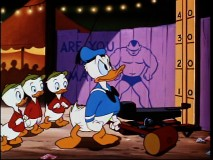 "Donald shows off his muscles at the carnival in ""Canvas Back Duck."""