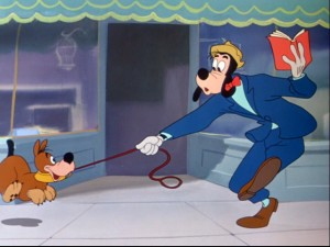 The puppy is Goofy's pet, but Goofy isn't quite his master.