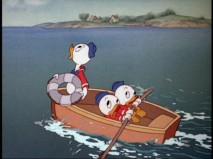 "In ""Sea Scouts"", Huey, Dewey, or Louie looks up at the gloomy skies while the other two row quickly towards ""Unca Donald."""