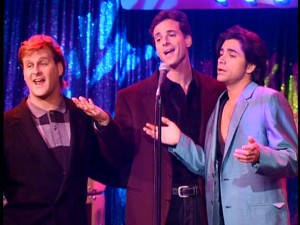 "The three leading men of ""Full House"" (Dave Coulier, Bob Saget, and Stamos) share a song at Jesse's newly-acquired Smash Club."