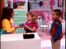 Denise (Jurnee Smollett) and Teddy (Tahj Mowry) each bribe Michelle to claim the part of her best friend.