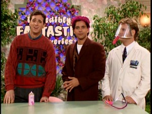 Danny, Jesse, and Joey record an infomercial for Jesse's new invention, the Sprayguard 2001. In case you can't tell from the magenta locks atop Uncle Jesse's carefully-coifed head, it is not a success.