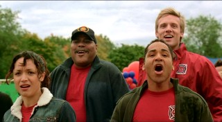 The four firefighters of Dogpatch (left to right: Mayte Garcia, Bill Nunn, Scotch Ellis Loring, and Teddy Sears) are as close as can be. Here, this quirky squadron cheers on Dewey, their designated canine, in a firehouse dog competition.