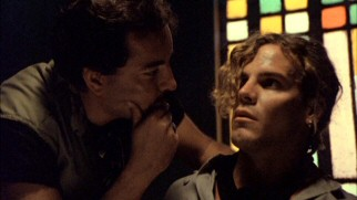 R.J.'s (Craig Sheffer) inquisitive nature and eagerness to photograph do not make him popular with the local police like Sanchez, who questions him as a suspect in front of a stained glass window.