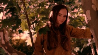 Juli Baker (Madeline Carroll) establishes herself as a literal tree hugger, as she clings to this tall Sycamore scheduled to be chopped down.