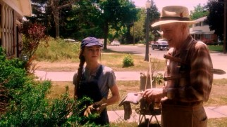 Juli (Madeline Carroll) gets some much needed landscaping assistance from Bryce's widowed grandfather Chet (John Mahoney).