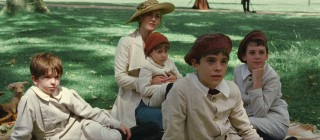 Sylvia Davies and her four young children become Barrie's audience in the park.