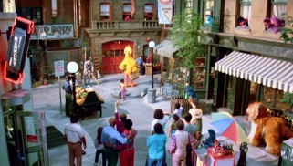 "Big Bird bids farewell to Sesame Street and it to him at the beginning of ""Follow That Bird."""
