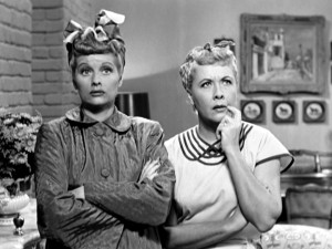"Lucy (Lucille Ball) and Ethel (Vivian Vance) rack their brains to think of a single man they can invite dancing in ""The Girls Want to Go to a Nightclub"", the first aired episode of ""I Love Lucy."""