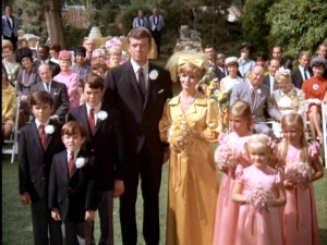 The Brady Bunch becomes The Brady Bunch as Mike (Robert Reed) and Carol (Florence Henderson) marry in front of their combined total of six children.