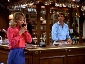 Cheers bartender Sam Malone (Ted Danson) looks and listens on while imminent love interest Diane (Shelley Long) gets some heartbreaking news from an airline attendant.