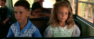 On his first day of school, young Forrest Gump (Michael Conner Humphreys) finds a friend and a seatmate in Jenny Curran (Hanna Hall).