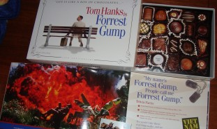 The 15th Anniversary Forrest Gump Giftset includes a book, scratch & sniff chocolate graphics, and a white feather (not pictured).