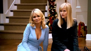 Courtney (Kristin Chenoweth) shares advice and cleavage with her sister Kate (Reese Witherspoon).