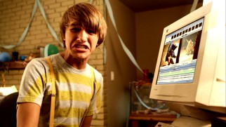 Fred Frigglehorn (Lucas Cruikshank) hesitates before uploading a video to the Internet, something that may or may not reflect the habits of the teenaged boy who created the character in a similar way.