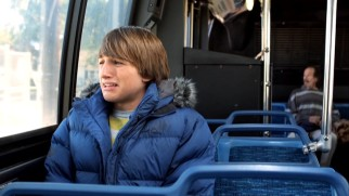 Riding the public bus by himself is an adventure in itself for Fred Frigglehorn (Lucas Cruikshank).