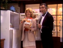 Elyse is joined by the Penguin (John McCook) in a commercial for frozen foods.