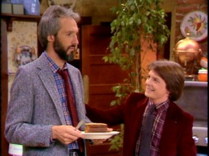 Smart Alex Keaton (Michael J. Fox) cracks wise in bonding with his bearded father Steven (Michael Gross).