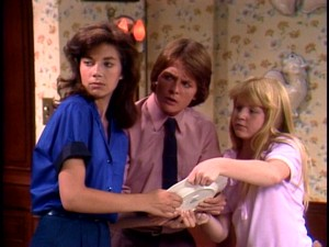 The Keaton kids -- Mallory (Justine Bateman), Alex, and Jennifer (Tina Yothers) -- try to glue a broken plate back together, when the phone rings.